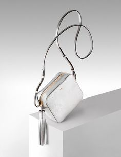 Anya Hindmarch bag shot by creative still life photographer Josh Caudwell. Luxury goods advertising photography