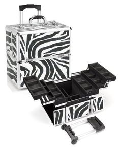 """Seya Professional Rolling Makeup Case w/ 6 Trays and Detachable Trolley - Zebra by Seya. $99.95. Removable telescoping handle fully extended height: 34.5"""". Easy to clean, black fabric interior. Heat resistant exterior to protect your cosmetics.. Storage space underneath trays perfect for storing larger tools and accessories. Total of 6 extendable trays with adjustable/removable dividers. Lock and key included for added safety and security of your cosmetics. Unique zebra vinyl..."""