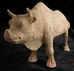 "T'ang Terracotta Sculpture of a Standing Ox - H.878 Origin: China Circa: 618 AD to 906 AD  Dimensions: 8"" (20.3cm) high  Collection: Chinese Medium: Terracotta"