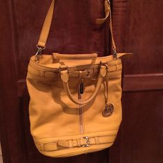 Michael Kors large yellow bucket bag Fabulous large summery yellow bag in great condition.  Inside and outside are clean.  Handle shows slight wear as shown in pic. KORS Michael Kors Bags Shoulder Bags