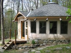 """This """"Mongolian-style yurt"""" and its smaller studio counterpart are currently for sale in the woods of central Vermont outside of Granville. Both buildings are hand-sculpted works of art crafted in an eco-friendly, eco-conscious manner."""