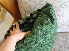 QUILLOW.. By sewing a special pocket into your quilt, the blanket folds up and fits inside itself to make a pillow