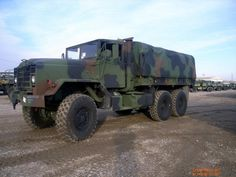 BMY Division of Harsco M923A2 5-Ton Cargo Truck w/ a 14-Foot Dropside Cargo Body