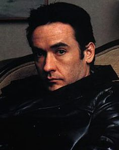 John Cusack. There is something weirdly attractive about this man. He's so ordinary looking, but I find him damn hot. He's also a great actor. :)