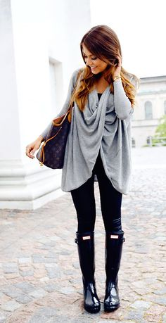 black leggings, a grey sweater and rain boots