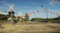 Seminole Gulf Railway Railroad Crossing Malfunctioning - Fort Myers Florida A Work train causes the railroad crossing arms to go down but once the vehicle is actually at the crossing the arms raise up potentially causing a problem.