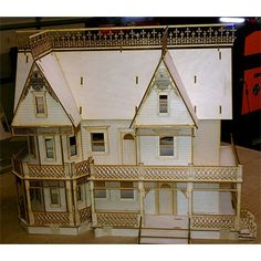 The Victorian Gingerbread Farmhouse 1:24 scale dollhouse measures 23W x 10D x 21H. It has detailed porch framing, Victorian gingerbread gable ornaments, window frames, Plexiglas window inserts, detailed stairs, railings and more. It has 9 rooms with an exit to the porch on the second floor.