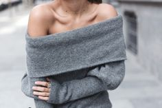 This off-the-shoulder grey sweater is such a statement piece.