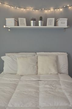 Calming... Light blue wall? Shelf above the bed seems so practical but is a little scary for me. #CozyBedroom  #WhiteBedroom  #BedroomForGirls  #BedroomForBoys Apartment Bedroom Decor, Small Apartment Bedrooms, Bedroom Decor Lights, Bedroom Wall Shelves, White Wall Shelves, Wall Decor Lights, White Lights Bedroom, Blue Shelves, White Wall Bedroom