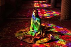 A woman sits at the Nasir al-Mulk mosque in Shiraz, Iran. (Photo Credit: Mihaela Noroc)