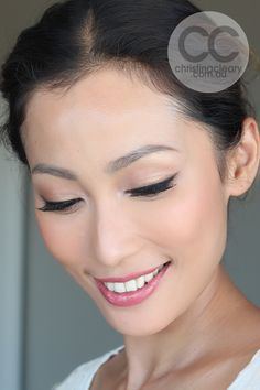 Beautiful, simple bridal makeup with a slight cat eye for some vintage flair