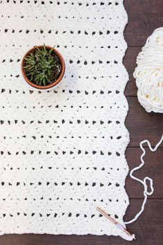 This chunky crochet blanket pattern is great for beginners and works up very quickly in Bernat Blanket yarn. Free pattern!