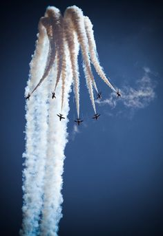 sttarlight: A photograph of the Red Arrows performing at the Santander British Grand Prix 2010, Silverstone. by Kapische