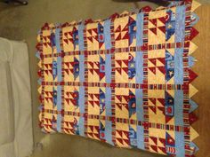 Baby boy nautical quilt. notice the triangle border.  Can do with squares folded diagonally twice