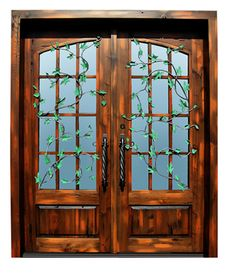 Wood doors with iron 'ivy' embellishment