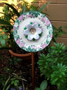 Make your own Garden Whimsies using permanent exterior silicone caulking to glue them together - use discarded dishes, etc....this site has lots of inspiration!!!!