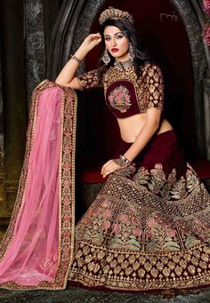 Velvet Circular Lehenga in Dark Maroon This attire with Poly Shantoon Lining is Enhanced with Resham, Zari, Stone and Patch Border Work Available with a Semi-stitched Velvet Choli in Dark Maroon and a Net Dupatta in Pink The Semi-stitched Lehenga Waist and Hips are customizable from 32 to 36 and 40 to 44 inches respectively. The Length of the Lehenga is 43 inches Do note: Accessories shown in the image are for presentation purposes only.(Slight variation in actual color vs. image is…