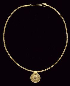 A GREEK GOLD NECKLACE AND PENDANT  HELLENISTIC PERIOD, CIRCA LATE 4TH-3RD CENTURY B.C.  Composed of a length of double loop-in-loop chain, each end terminating in a ridged tubular collar with a loop at the end, a large hook looped to one, the convex disk pendant with a rosette centered by a collar set cabochon garnet, framed by ribbon and beaded wire, the ribbed suspension loop with a single granule at the join to the disk