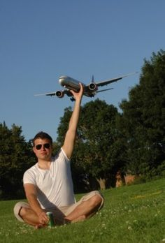 Man Grabs Aeroplane - Perfectly Timed Photos