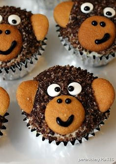 Chocolate Cupcakes filled with Vanilla Buttercream then decorated as monkeys with Vanilla Wafers {Persnickety Plates}