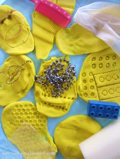 Although this seems like a younger child's activity, this teaches students how imprints are made on coins.  Students will push anything with texture, like coins, onto the play-dough and see what imprints they make.