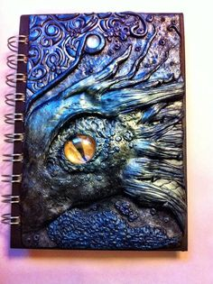 Handmade Polymer Clay Dragon Journal Cover. And the awesome thing, besides the incredible artistry and imagination, is that these covers are reusable! The possibilities are endless.: