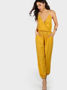 Shop Self Tie Halter Surplice Slanted Pocket Front Tapered Jumpsuit online. SheIn offers Self Tie Halter Surplice Slanted Pocket Front Tapered Jumpsuit & more to fit your fashionable needs.