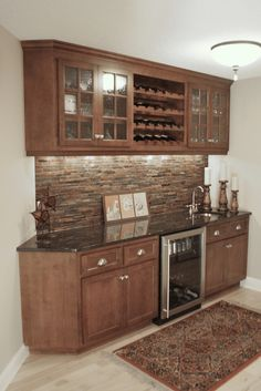 This bar is directly adjacent to the kitchen making it a nice side attraction for wandering guests. Given it's proximity to the kitchen, the granite counter top also doubles as an additional serving space.