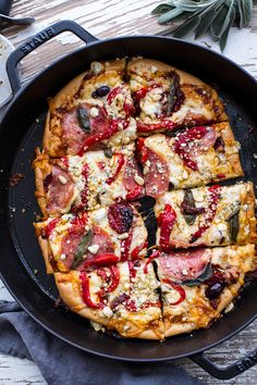 Sun-Dried Tomato and Olive Pesto Pizza with Salami + Roasted Red Peppers.