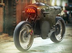 in addition to the name, the sinister electric cafe racer's form appears to be take on a menacing stance with flaming headlamps for 'eyes'.