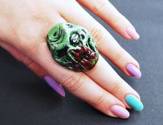 zombie face adjustable ring via Etsy.  Just what every girl wants.