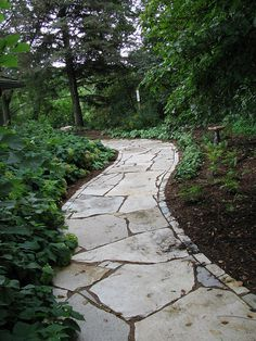 I like the brick-size edging, as it brings some visual control to the giant chaotic flagstone pieces. Fond du Lac Flagstone and Landscape Edging by Buechel Stone, via Flickr