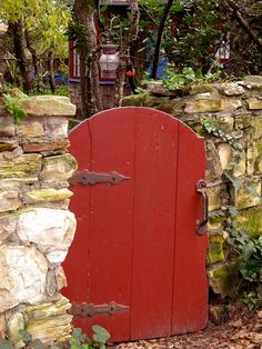 Red Garden Gate with stone fence posted by Miss Bee's Haven on Facebook http://on.fb.me/LmAL27