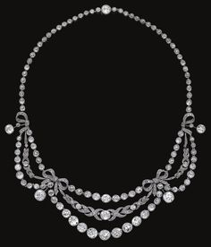 Diamond necklace, circa 1910. In the Garland Style, designed as stylised swags of millegrain set cushion-shaped, circular-cut and rose diamonds, embellished with ribbon bows and foliate motifs, mounted in platinum, length approximately 385mm, French assay and maker's marks.