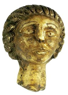 """Carved marble female in profile with long hair in a bun. Dark encrustation.      200 AD  3 1/2"""""""