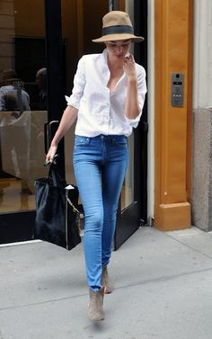 Miranda Kerr - white shirt + skinny jeans, ankle boot, shopper and floppy fedora