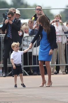 The young Prince looked in adorable shorts and a white T-shirt with his customary Start Ri...