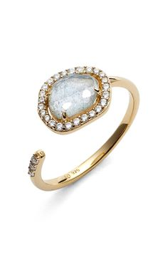 Both modern and classic, this glistening vermeil ring is made with an openwork silhouette punctuated with a faceted semiprecious stone and sparkling cubic zirconias.