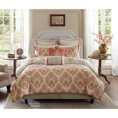The Harbor House Kalia bedding collection provides the perfect combination of classic and modern design. This coral comforter features an updated damask pattern in shades of yellow and orange that creates a sophisticated look.