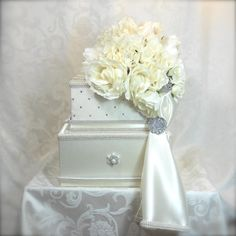 Dimensions: 10 square (bottom tier) x approximately17 high with bouquet      NOT INCLUDED IN THE PRICE:    . Swavorski crystals that are hand