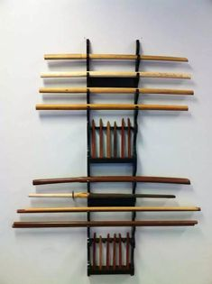 Weapons Rack: this is a general setup common to JuJutsu, Aikido and Hapkido, depicting practice weapons