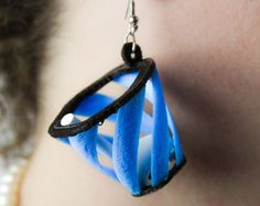 3D-printed earring baskets catch your falling AirPods     - CNET  Enlarge Image  Catch your AirPods in these wearable 3D-printed baskets.                                             M3D                                          Since they were announced Apples wireless AirPods earphones have been the subject of concern as well jokes. Most of this stems from worries over how easy it could be to lose the expensive and untethered gadgets.   So how do you wear AirPods and maintain your peace of…