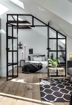 The black framed glazing that separates sleeping and living zones is the most striking feature of this captivating Stockholm loft apartment via Alexander White Stockholm. Styled by Scandinavian Homes & photographed by Henrik Nero.