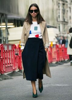 Natasha Goldenberg makes a simple but effective statement in her arty knit with a midi skirt and trench coat. | @andwhatelse