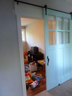 barn door to the playroom. Great idea!