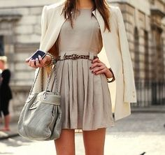 A neutral monochromatic outfit with a skinny leopard belt.