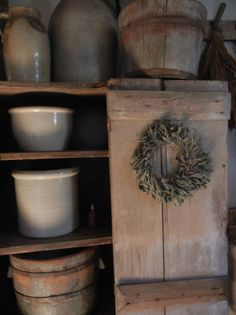 Old Cupboard...filled with old stoneware crocks & buckets.