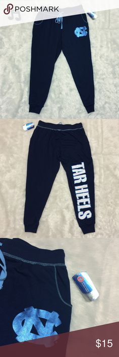 UNC Tarheels Cropped Joggers / Sweatpants Officially licensed, new with tags and perfect condition. See measurements in photos for sizing questions.  🔽🔽🔽🔽🔽🔽🔽🔽🔽🔽🔽🔽🔽🔽🔽🔽🔽🔽🔽🔽  • Reasonable offers accepted • Sorry, no modeling & no trades  🔼🔼🔼🔼🔼🔼🔼🔼🔼🔼🔼🔼🔼🔼🔼🔼🔼🔼🔼🔼 Officially Licensed Collegiate Product Pants Track Pants & Joggers