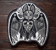 Love Bat by Bryn Perrott. Hand carved woodcut measuring 13 inches tall and wide.