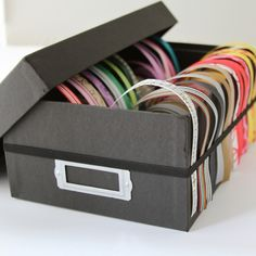 Turn a shoebox into a ribbon dispenser! Tutorial here: http://creamcityribbonblog.com/tag/how-to-make-a-ribbon-storage-box/